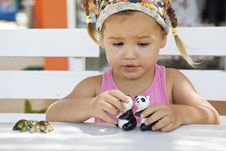 Free A Girl Playing With Toy Pandas At The Table Stock Photography - 22271002