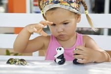 Free A Girl Playing With Toy Pandas At The Table Stock Photo - 22271010