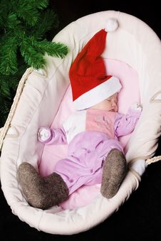 The Little Baby In Winter Boots And A Hat Royalty Free Stock Photos