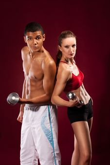 Free Strong Young Man And Woman With Dumbbells Stock Photography - 22273722