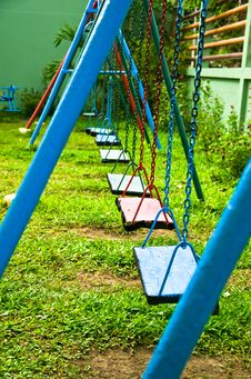 Free Blue And Red Swings Hanging In The Park Stock Images - 22277314
