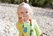 Free Cute Baby Girl Holding Out A Pebble Royalty Free Stock Photos - 22290368