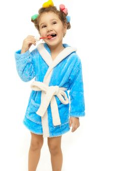 Free Happy Girl Brush Her Teeth In Blue Dressing Gown Stock Photography - 22294862