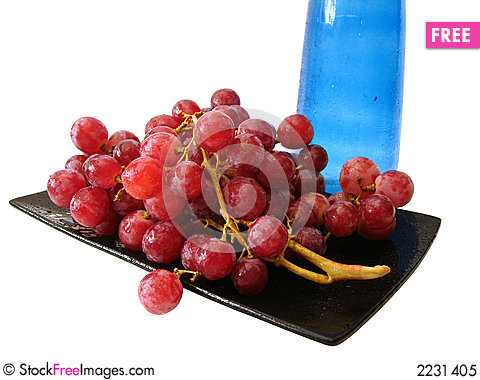 Free Dish With Grapes And Bottle Royalty Free Stock Photo - 2231405