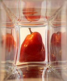 Red Ripe Pear In The Glass Box Royalty Free Stock Photo