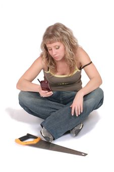Woman With A Phone And A Saw Stock Photography