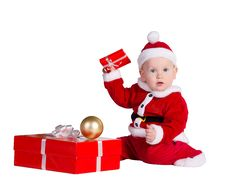 Free Little Baby Santa With Christmes Prenets Royalty Free Stock Photos - 22306148