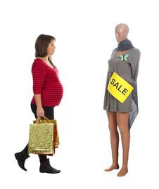 Free Nice Pregnat Woman Choosing A Dress Royalty Free Stock Photos - 22306168