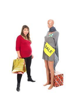 Free Nice Pregnat Woman Choosing A Dress Stock Photo - 22306170