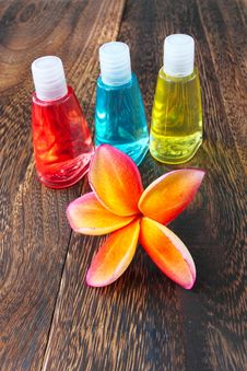 Free Toiletries And Plumeria Flower On Wood Floor Royalty Free Stock Images - 22313699
