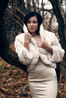 Elegant Girl In White Coat With High Collar Royalty Free Stock Photo