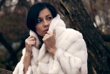 Elegant Girl In White Coat With High Collar Royalty Free Stock Photos