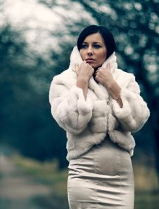 Elegant Girl In White Coat With High Collar Royalty Free Stock Image