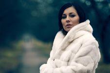 Elegant Girl In White Coat With High Collar Stock Photo