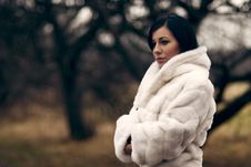Elegant Girl In White Coat With High Collar Royalty Free Stock Images
