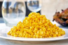 Free Corn On A Plate As Part Of A Dinner Table Set Up Royalty Free Stock Image - 22323386