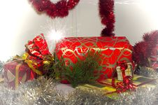 Free Christmas Gifts Closeup And Bengal Sparkler Stock Photography - 22337052