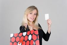 Young Girl With Bag Shows A Blank Plastic Card