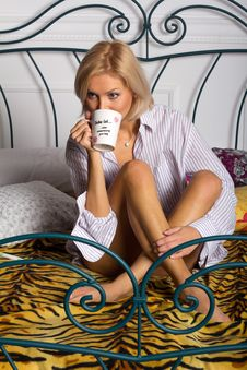 Free Young Woman Drinking Coffee On The Bed Stock Image - 22347201