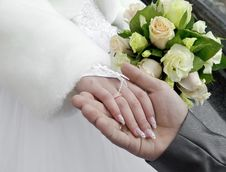 Free Groom Holds The Hand Of Fiancee Royalty Free Stock Images - 22352479