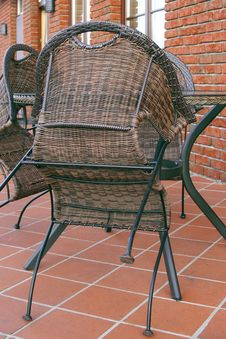 Wicker Chairs And A Table In A Cafe Royalty Free Stock Images