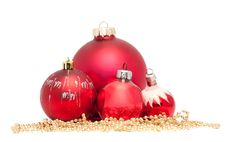 Four Red Christmas Balls With Golden Beads Stock Photos