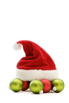 Free Santa Hat And Ornaments  On White Stock Photography - 22360632