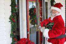Free Santa Delivers A Poinsettia Plant Royalty Free Stock Photos - 22366968