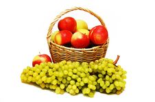 Free Apples In A Basket And Grapes In The Foreground Royalty Free Stock Photography - 22367087