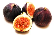 Free Three Figs, One Is Cut, Ripe Pulp Stock Image - 22367171