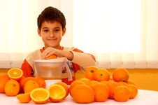Free Child With Oranges Royalty Free Stock Photography - 22376597