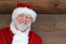 Free Santa Against A Log Cabin Wall Stock Image - 22379421