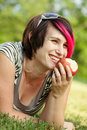 Free Young Punk Woman Eating An Apple Stock Photography - 22388192