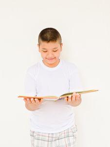 Free Asian Boy Reading Book Royalty Free Stock Photos - 22386638