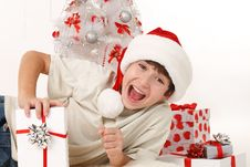 Free Cheerful Child With Christmas Gifts Royalty Free Stock Photo - 22395965