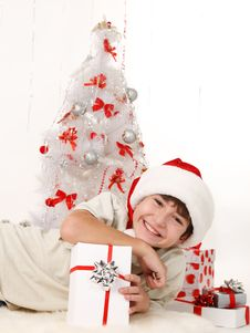 Cheerful Child With Christmas Gifts Stock Photos