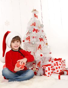 Free Little Girl With Christmas Present Stock Photo - 22398200