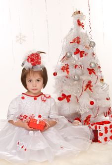 Free Little Girl With Christmas Present Stock Photo - 22398240
