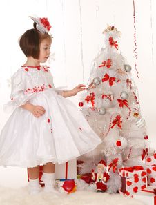 Free Little Girl Standing Near A Christmas Tree Stock Photos - 22398263