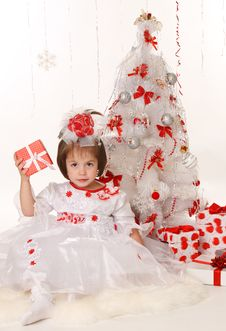 Free Little Girl With Christmas Present Stock Photo - 22398280