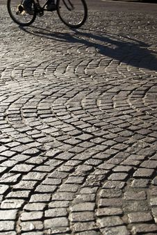 Free Squared Old Paving With Passing Bicycle Royalty Free Stock Images - 22398419