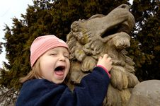 Free Little Girl And Lion Royalty Free Stock Photo - 2240005