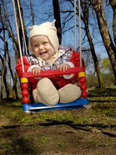 Free Swinging Little Boy Stock Photo - 2240220