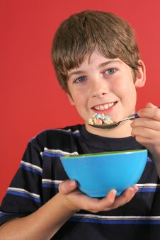 Free Boy Eating Cereal Vertical Stock Photos - 2249943