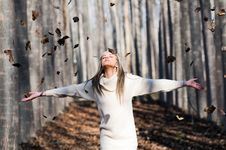 Free Girl With Falling Leaves In The Woods Royalty Free Stock Images - 22402709