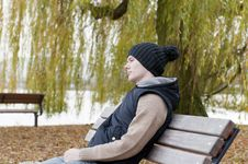 Free Man Sits On The Bench Royalty Free Stock Photos - 22414048