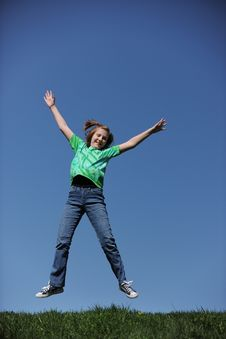 Free Young Girl Jumpingon A Sunny Day Royalty Free Stock Images - 22414129
