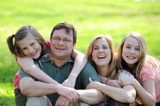 Free Young Couple With Daughters Royalty Free Stock Image - 22414156