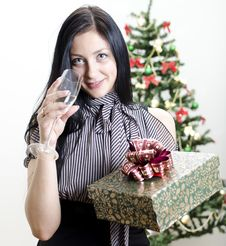 Christmas: Girl With Gift Stock Photo