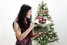 Free Christmas: Brunette Girl With Gift Stock Photo - 22418430